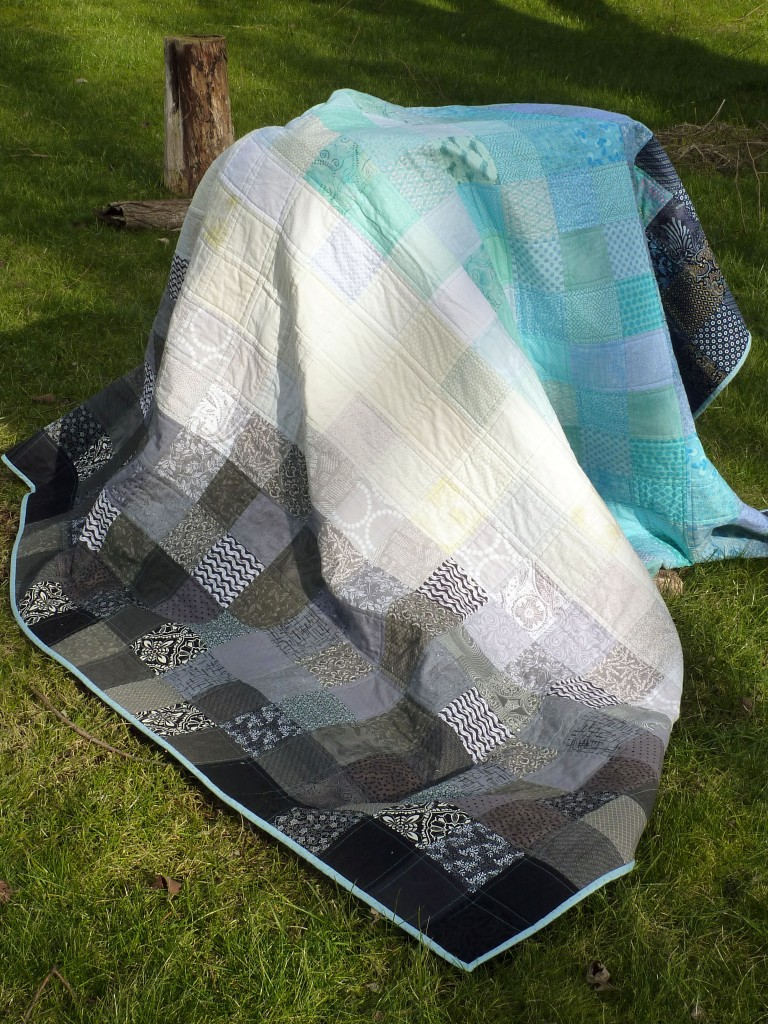 Too windy to hold the quilt up so I draped it on a tree stump