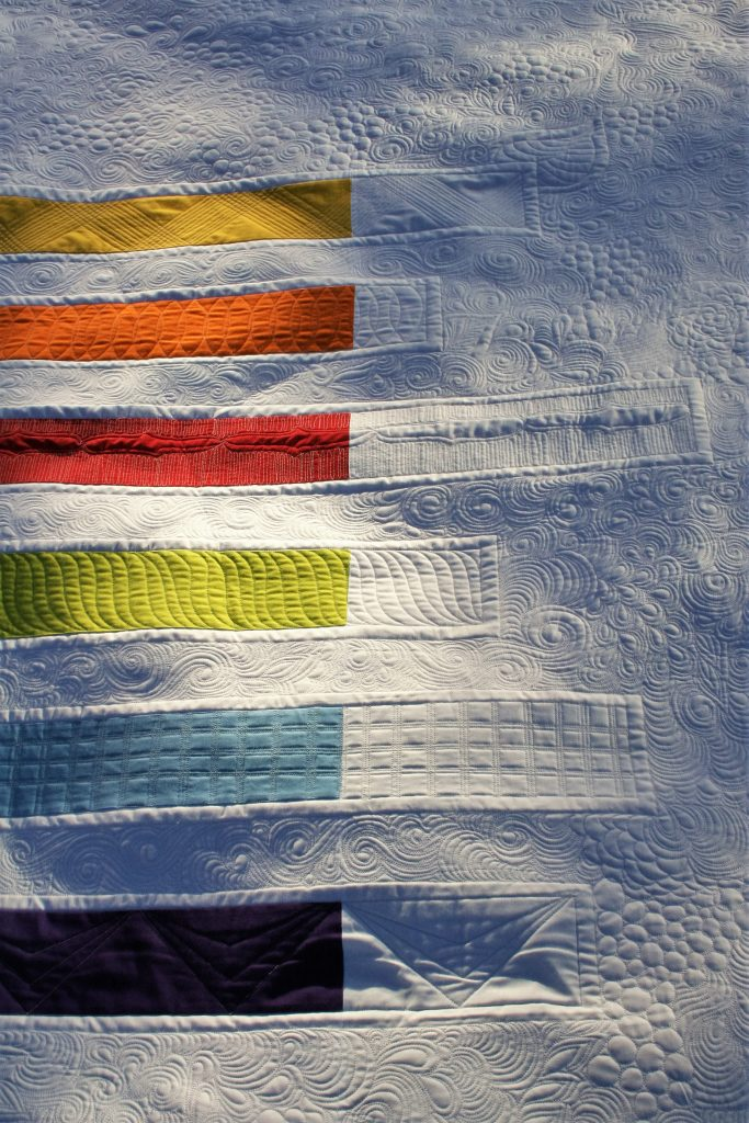 longarm-quilting-negative-space-rainbow